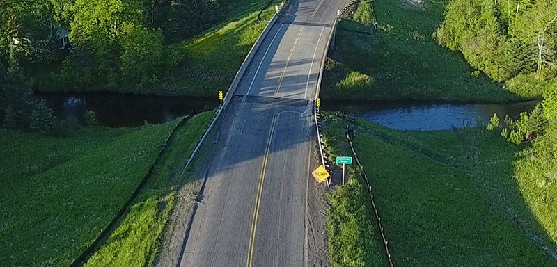 aerial view of Amnicon River bridge crossing after topsurface grinding phase of highway